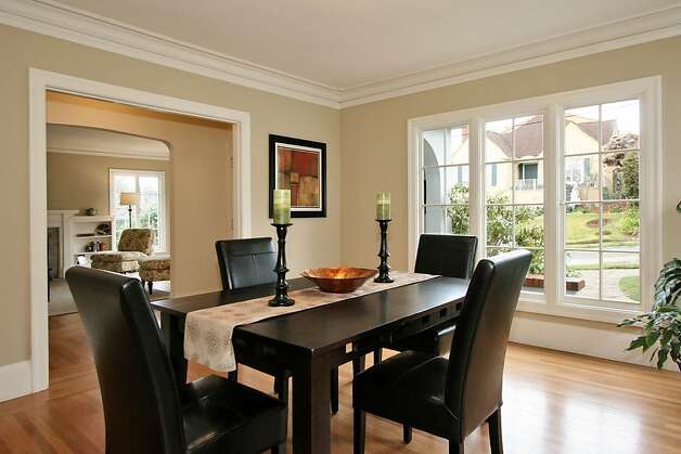 The formal dining room has wide open entries to both the front hall and kitchen. Photo: Liz Rusby