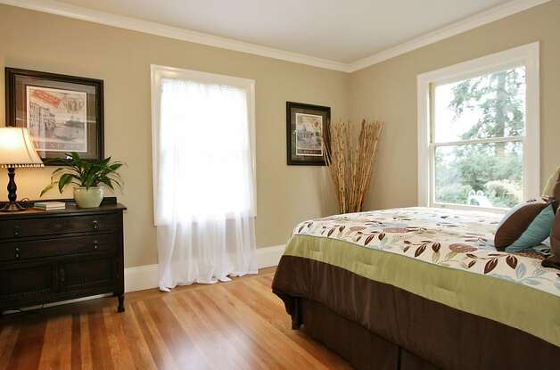 One of the four bedrooms. This home, nestled in the quaint Crocker Highlands neighborhood, exemplifies the English country cottage archetype. Photo: Liz Rusby