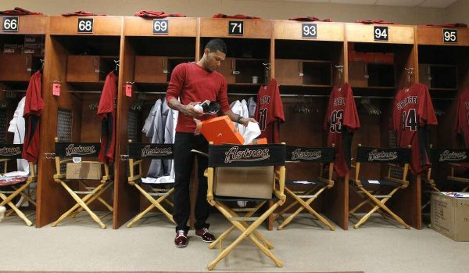 Astros pitcher Jorge DeLeon unpacks new shoes as he moves into his locker. (Karen Warren / Chronicle