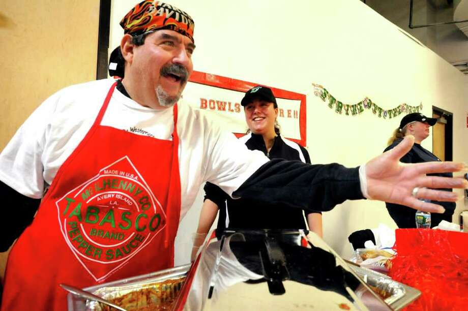 Tony Mazza of Great Bowls of Fire, talks about how hot his chili really is at the annual Chili Winter Warm-Up in the Danbury Ice Arena Sunday, Feb.19, 2012. Photo: Michael Duffy / The News-Times
