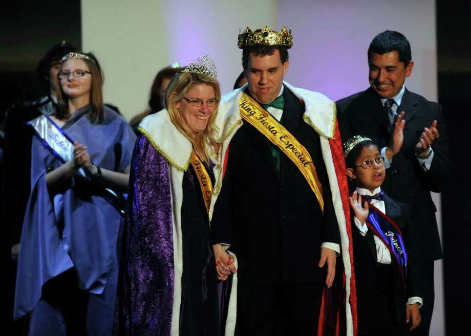 Queen Melissa Cochran, left, and King Jamie Marr acknowledge ovations after being crowned during the Fiesta Especial coronation held at Morgan's Wonderland during the Hand in Hand Runway Benefit on Saturday, Feb. 18, 2012. Fiesta Especial is a Fiesta San Antonio event for children and adults with physical, cognitive and developmental differences  and their friends and families.  Billy Calzada / San Antonio Express-News Photo: Billy Calzada, San Antonio Express-News / San Antonio Express-News