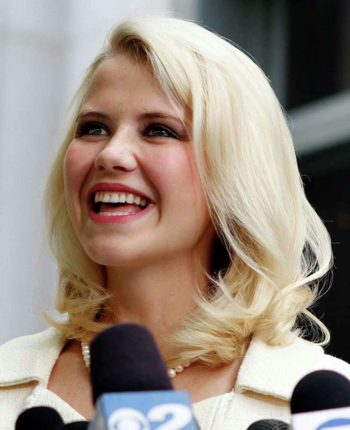 FILE - This May 25, 2011 file photo shows Elizabeth Smart talking to the media in front of the Frank E. Moss Federal Courthouse in Salt Lake City. A family spokesman says the Utah woman who was kidnapped at knifepoint at age 14 and held captive for nine months married Matthew Gilmour on Saturday Feb. 18, 2012 in Oahu. The 24-year-old Smart is a senior at Brigham Young University. She met Gilmour, of Aberdeen, Scotland, while serving a Church of Jesus Christ of Latter-day Saints mission in France. (AP Photo/Jim Urquhart, File)