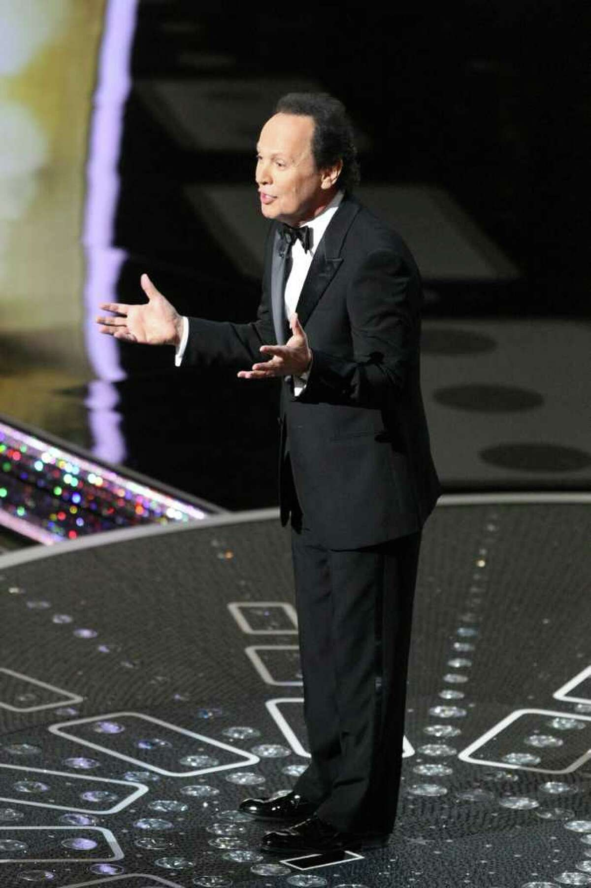 FILE -- Billy Crystal during the 83rd Academy Awards at the Kodak Theater in Los Angeles, Feb. 27, 2011. Crystal will return to host the 84th Academy Awards, an event whose criticism only adds to the hype. (Monica Almeida/The New York Times) -- PHOTO MOVED IN ADVANCE AND NOT FOR USE - ONLINE OR IN PRINT - BEFORE FEB. 19, 2012.