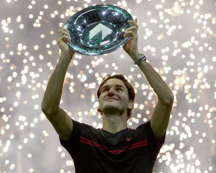 Roger Federer admires the trophy after defeating Juan Martin del Potro 6-1, 6-4 in the final of the ABN Amro tournament. Photo: AP