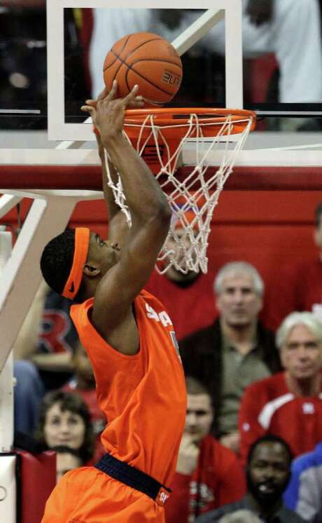 Syracuse's  C.J. Fair tips in a basket during the first half against Rutgers. Fair finished with 21 points. Photo: AP