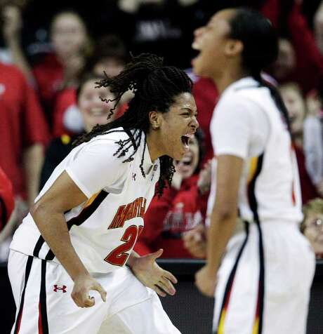 Maryland's Tianna Hawkins (left) celebrates after being fouled while scoring during a win over Duke. Photo: AP