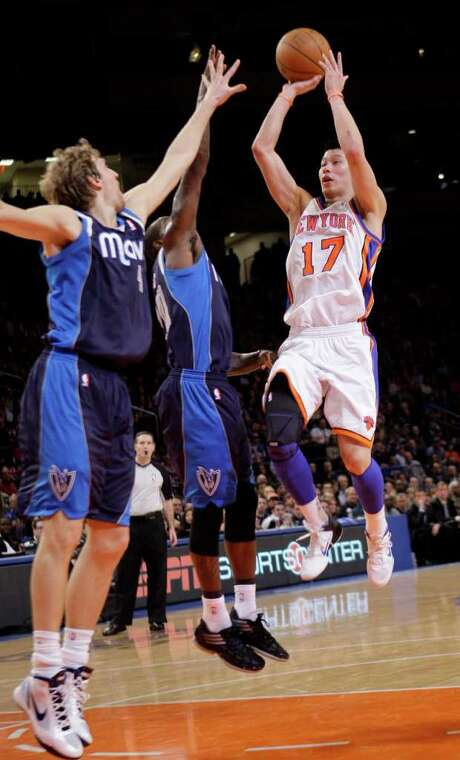 New York's Jeremy Lin shoots over Dallas' Dirk Nowitzki and Dominique Jones during the first half. Lin had 28 points and a career-high 14 assists. Photo: AP
