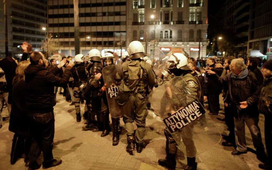 Demonstrators shout at riot police in Athens, Greece, on Sunday during a  protest ahead of this week