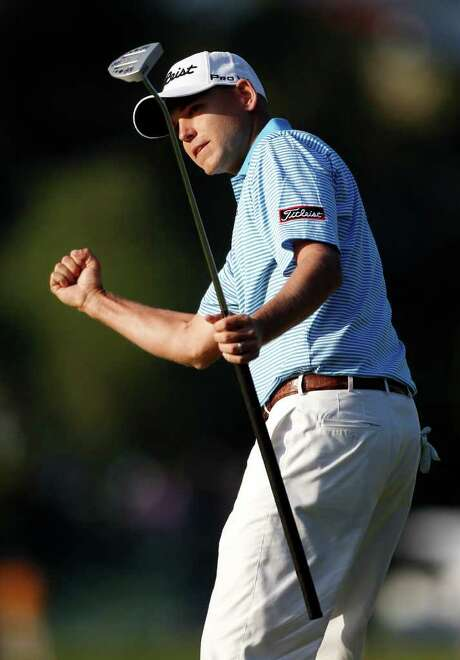 Bill Haas celebrates after beating Phil Mickelson and Keegan Bradley on the second playoff hole at Riviera Country Club. Photo: AP