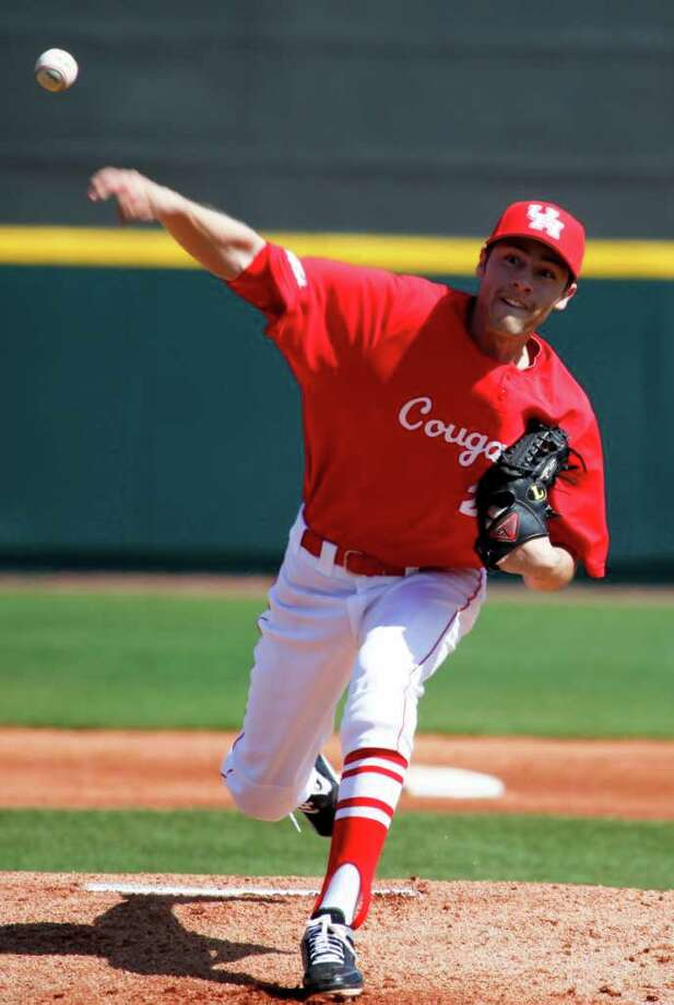 Cougar Aaron Garza is the opening pitcher as the University of Houston plays Delaware in its opening series of the college baseball season Feb. 19, 2012 in Houston. Photo: Eric Kayne, For The Chronicle / © 2011 Eric Kayne