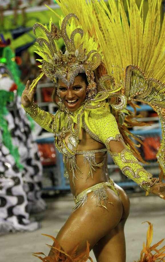 A performer from the Renascer de Jacarepagua samba school dances during a carnival parade at the Sambadrome in Rio de Janeiro, Brazil, Sunday Feb. 19, 2012. Photo: Silvia Izquierdo
