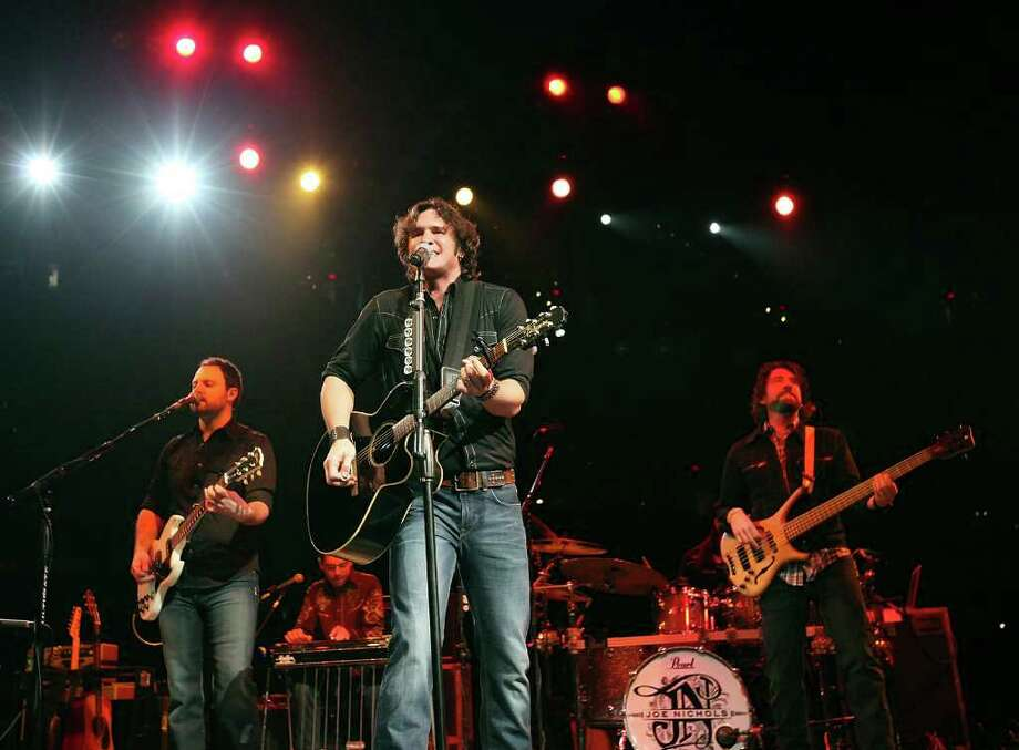 FOR METRO -  Joe Nichols performs during the San Antonio Stock Show & Rodeo Sunday Feb. 19, 2012 at the AT&T Center. Photo: EDWARD A. ORNELAS, SAN ANTONIO EXPRESS-NEWS / © SAN ANTONIO EXPRESS-NEWS (NFS)