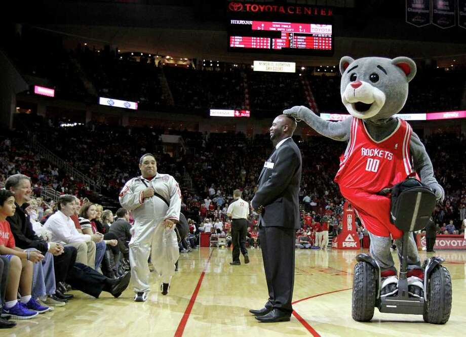 "2/19/12: Houston Rockets mascot ""Clutch"" teases the security guard during a timeout in the second half at the Toyota Center in Houston, Texas. For the Chronicle: Thomas B. Shea Photo: Thomas B. Shea, For The Chronicle / © 2011 Thomas B. Shea"