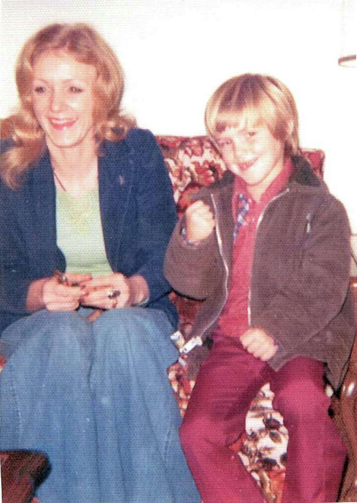 A murder victim who has just been identified as Gloria Faye Stringer is seen in a photograph with her son Dan Moore. The picture was taken shortly before she disappeared in 1975.