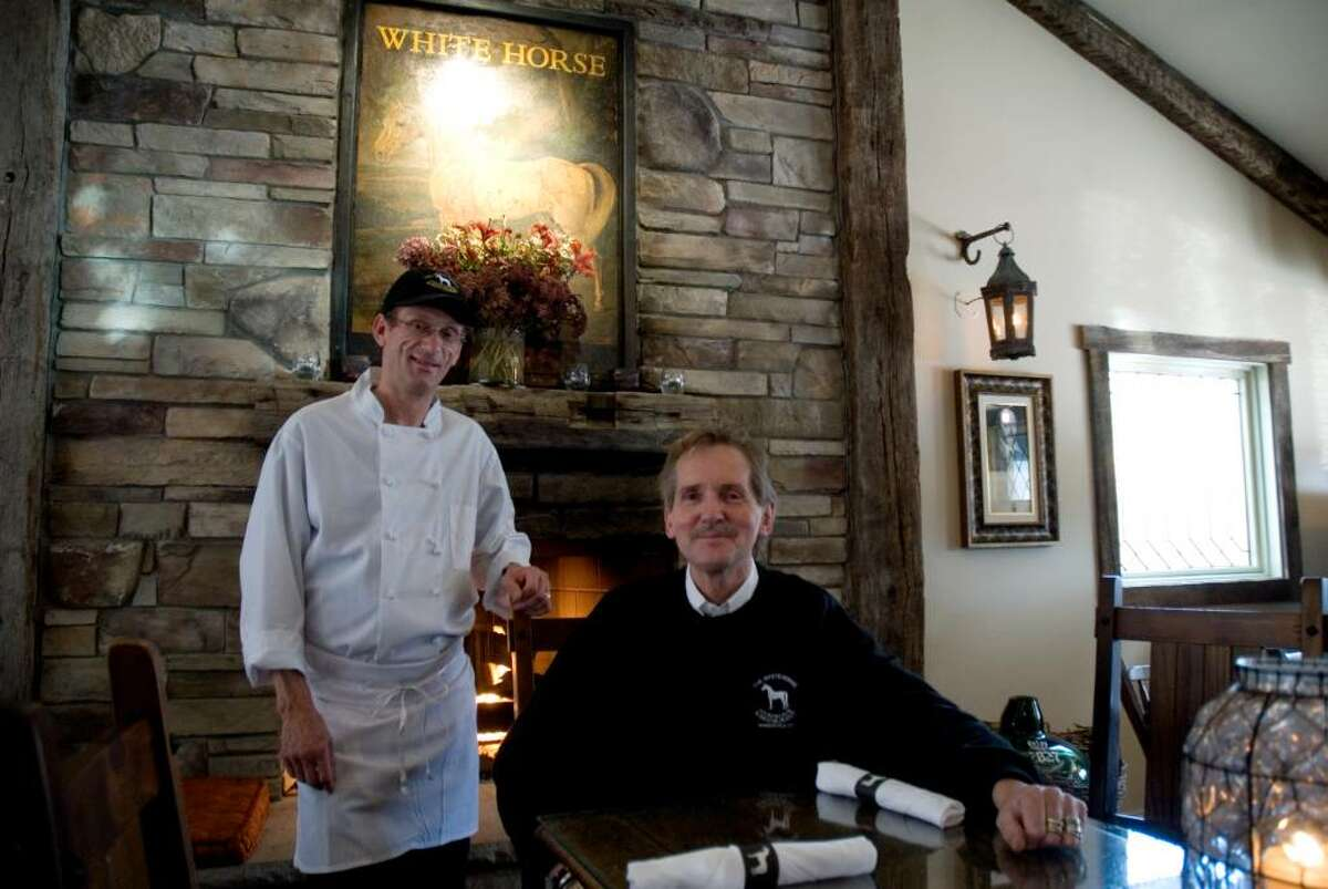Chef Fabris Denis and owner John Harris in front of the fire place in The White Horse, A Country Pub & Restaurant, Thursday afternoon.