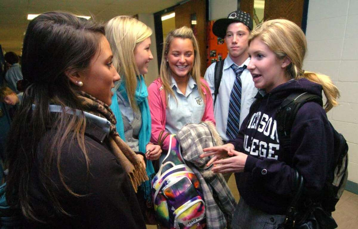 From left, Rachel Biasetti, 17, Christina Foley, 17, Melinda Corso, 18, Brandon Jordano, 17 all chat with Megan Mitchell, 17, after school at Immaculate High, Tuesday, Nov. 10, 2009.