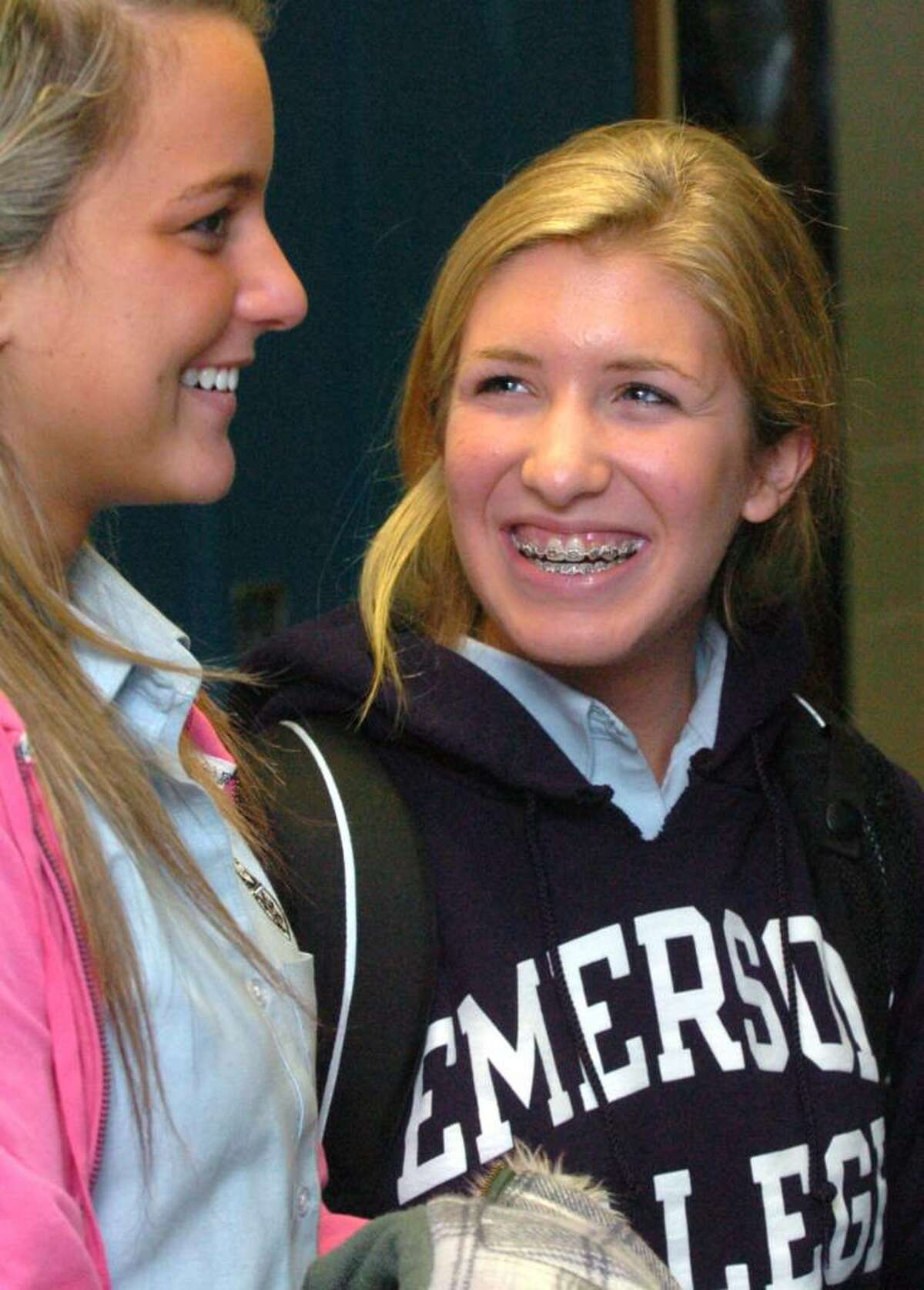 From right, Megan Mitchell, 17, chats with Melinda Corso, 18, after school at Immaculate High, Tuesday, Nov. 10, 2009.