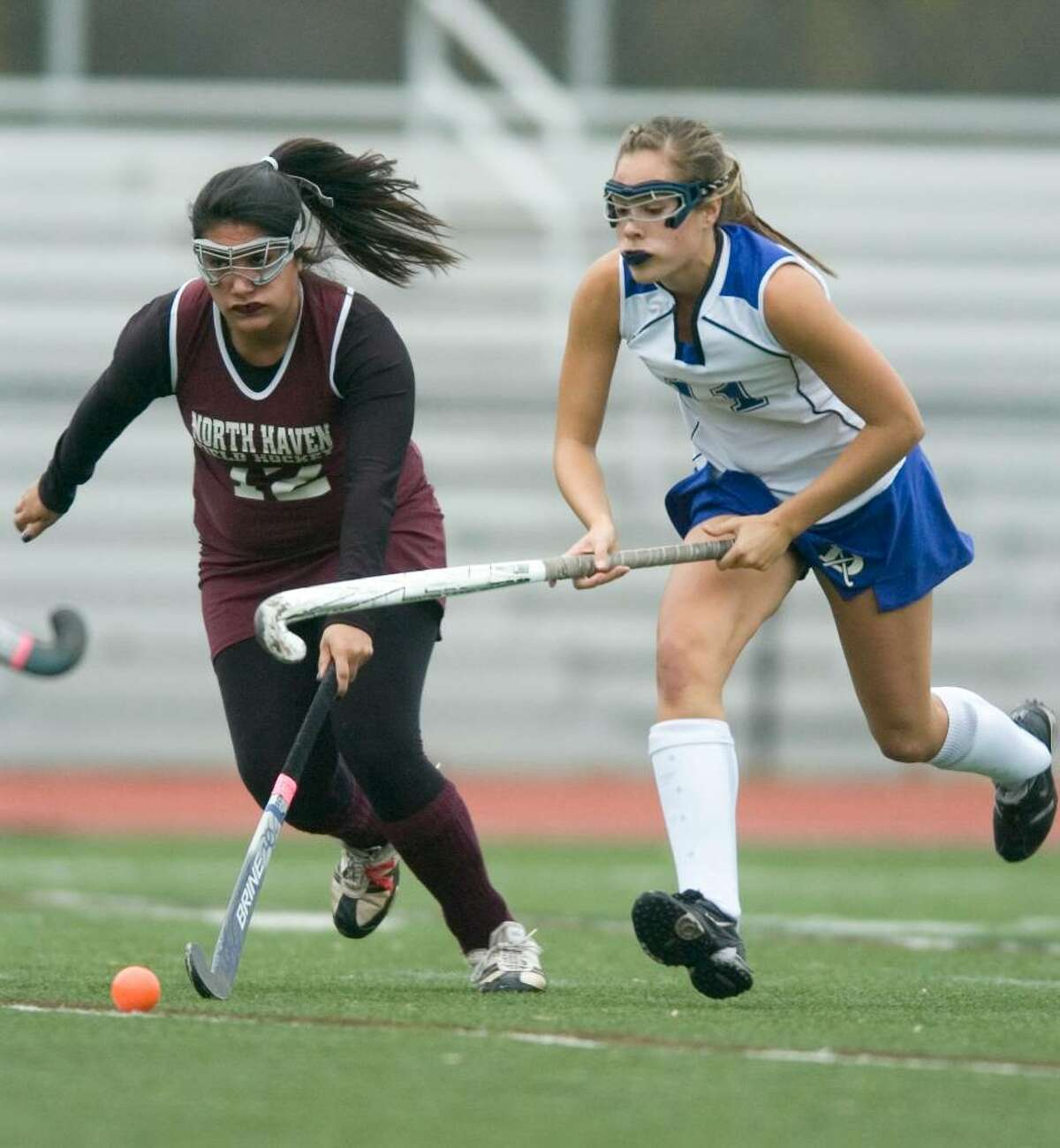 Darien's Alex Bair, right, and North Haven's, Alia Mahmood, left, during the first round of the CIAC girls field hockey tournament at Darien High School in Darien, Conn. on Tuesday, Nov. 10, 2009.