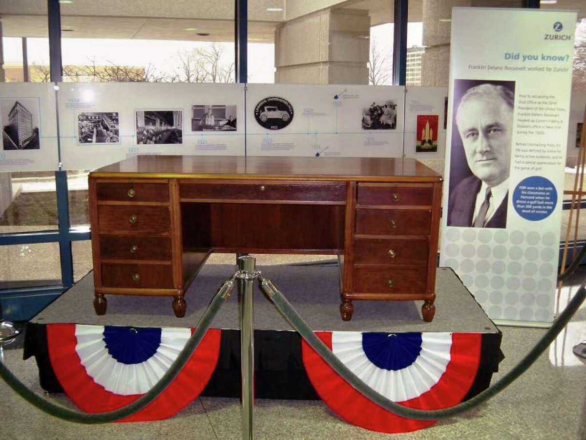 In an undated photo provided by the Zurich ?American ?Insurance? Company?, a desk used by Franklin Delano Roosevelt when he worked for Fidelity & Deposit?'s New York office, from 1921 through 1928, sits on display at company headquarters in Schaumburg, Ill. The walnut executive desk was kept at the now-defunct Fidelity and Deposit Co. in Manhattan for nearly 60 years. Roosevelt resigned from the firm after being elected governor of New York in 1928. Zurich American Insurance Co. owns the desk and will display it at its headquarters in suburban Chicago. This spring, the vintage office furniture will be donated to the Franklin D. Roosevelt Library and Museum in Hyde Park, N.Y. (AP Photo/Zurich ?American ?Insurance? Company?)