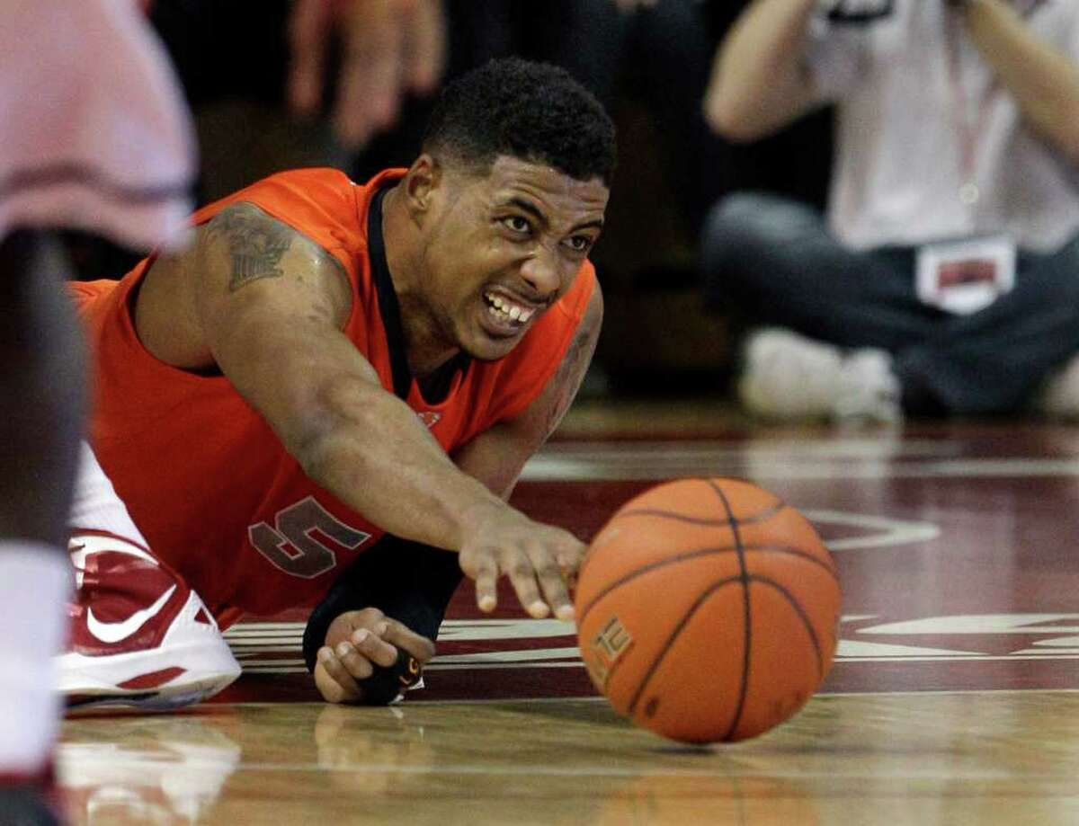 Syracuse's Fab Melo, of Brazil, dives for the ball during the second half of an NCAA college basketball game against Rutgers in Piscataway, N.J., Sunday, Feb. 19, 2012. Syracuse won 74-64. (AP Photo/Mel Evans)
