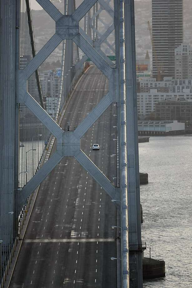 A lone car is seen on the Bay Bridge from Treasure Island on Sunday, February 19, 2012. The Bay Bridge was closed due to construction and demolish throughout the weekend. Photo: Sean Culligan, The Chronicle