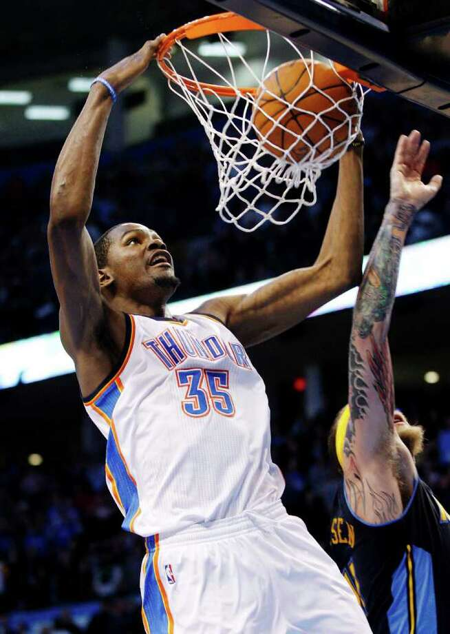 Oklahoma City's Kevin Durant dunks on Denver's Chris Anderson in the fourth quarter. Photo: AP