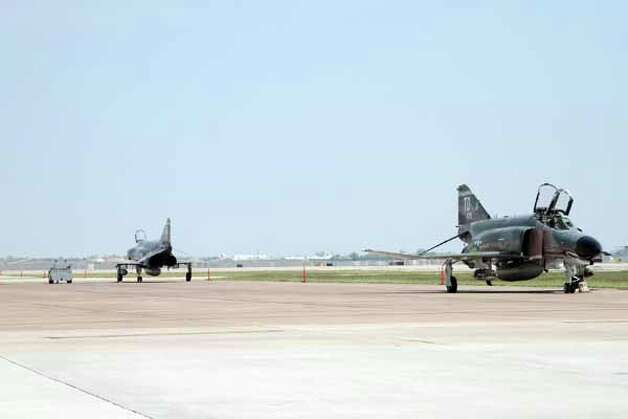 Ellington Field is also a designated site for military craft stop overs. Photo by Pin Lim. Photo: Pin Lim, Houston Chronicle / Copyright Pin Lim.