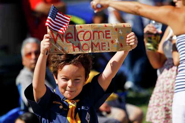 Levi Fox, 7, of Boy Scout Troop 806 holds a sign welcoming the return of the Houston-based 1st Battalion, 23rd Marine Regiment to Ellington Field after a seven-month combat tour in Afghanistan, Saturday, Oct. 1, 2011, in Houston.   Three-hundred and thirty-seven Marines returned home to Houston to cheers from an estimated 1000 people. Photo: Michael Paulsen, Houston Chronicle / © 2011 Houston Chronicle