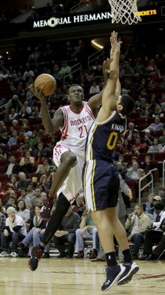 Rockets center Samuel Dalembert (21) scores over Utah Jazz forward Enes Kanter in the first half. (T
