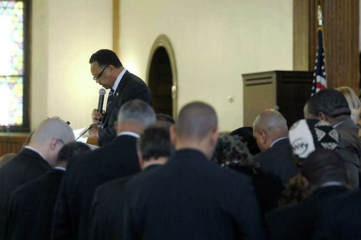 The Rev. Jesses Jackson, Sr., background left, is surrounded by political and union officials as he prayed for them during service at Wilborn Temple First Church of God in Christ on Sunday, Feb. 19, 2012 in Albany, NY. The service was part of The New York State Association of Black and Puerto Rican Legislators, Inc. weekend. (Paul Buckowski / Times Union)