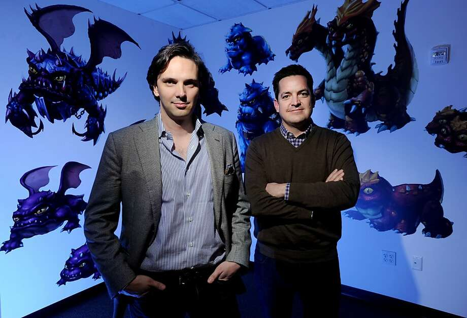 Kixeye CEO Will Harbin, left, and chief marketing officer Brandon Barber pose at their company's San Francisco headquarters on Thursday, Feb. 16, 2012. Photo: Noah Berger, Special To The Chronicle