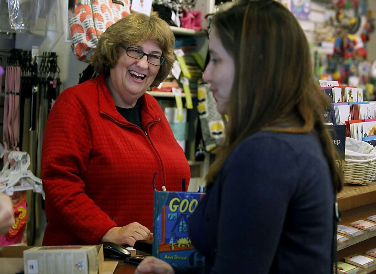 Store owner Carol Yenne (left) assists Dawn Deems at Yenne's Small Frys childrens' clothing store in the Noe Valley neighborhood of San Francisco, Calif. on Friday, Feb. 17, 2012. Noe Valley has continued to be a hot real estate market.