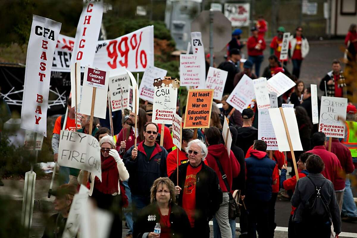 In this file photo, California State University faculty, staff and supporters picket at CSU in Hayward in 2011, as part of a strike protesting for faculty pay adjustments.