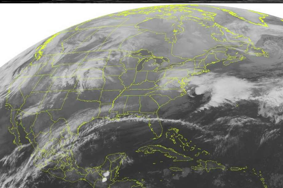 This NOAA satellite image taken Monday, Feb. 20, 2012 at 12:45 a.m. EST shows  dense cloud cover off the Mid-Atlantic coast that highlights a low pressure system in the nearby western Atlantic.  Rain and snow showers continue near the coastal areas of Virginia and North Carolina as this system exits the coast. (AP PHOTO/WEATHER UNDERGROUND) / WEATHER UNDERGROUND