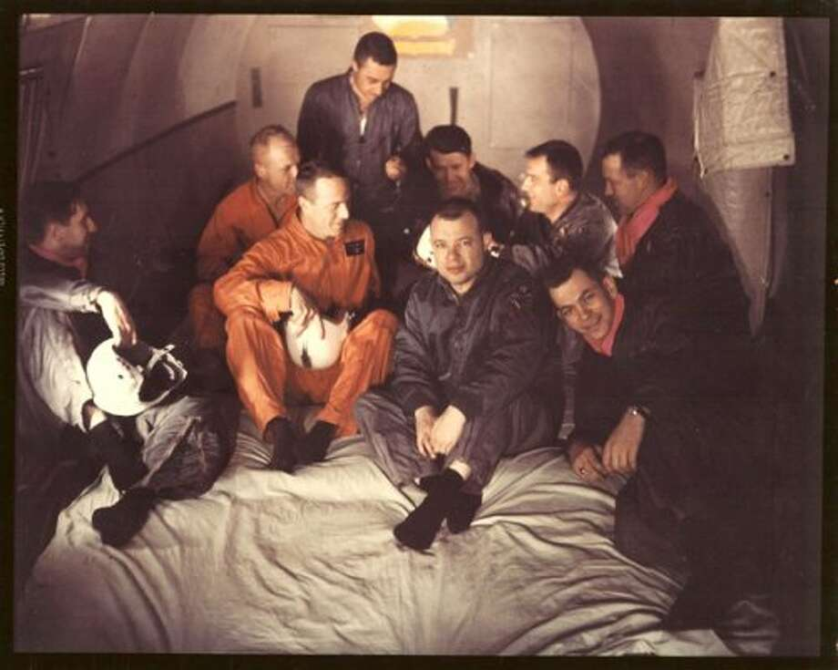 "Joseph P. Loftus Jr. in the ""Vomit Comet,"" an airplane that simulates weightlessness in preparation for the Mercury astronauts in training. Loftus is at extreme left. The astronauts from left to right rear are John Glenn, M. Scott Carpenter (top), Walter M. Schirra Jr., Donald K. ""Deke"" Slayton, and L. Gordon Cooper Jr. In front right of center is Navy Lt. Robert Voas, part of a medical team that assisted in training of the astronauts.  (NASA PHOTO)"