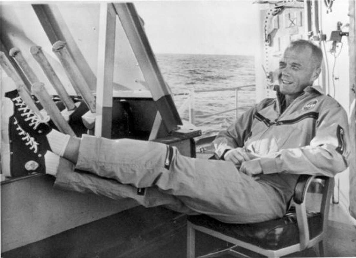 PHOTOS: Things you probably didn't know about John Glenn's historic space shot In this file photo, America's first orbital space pilot, John Glenn, enjoys a few moments of relaxation aboard the destroyer Noa, which picked him up in the Atlantic at the end of his historic 1962 space flight. Glenn was taken to Grand Turk Island for two days of post-flight examination. Click through to learn more about Glenn's trip to near-Earth orbit...