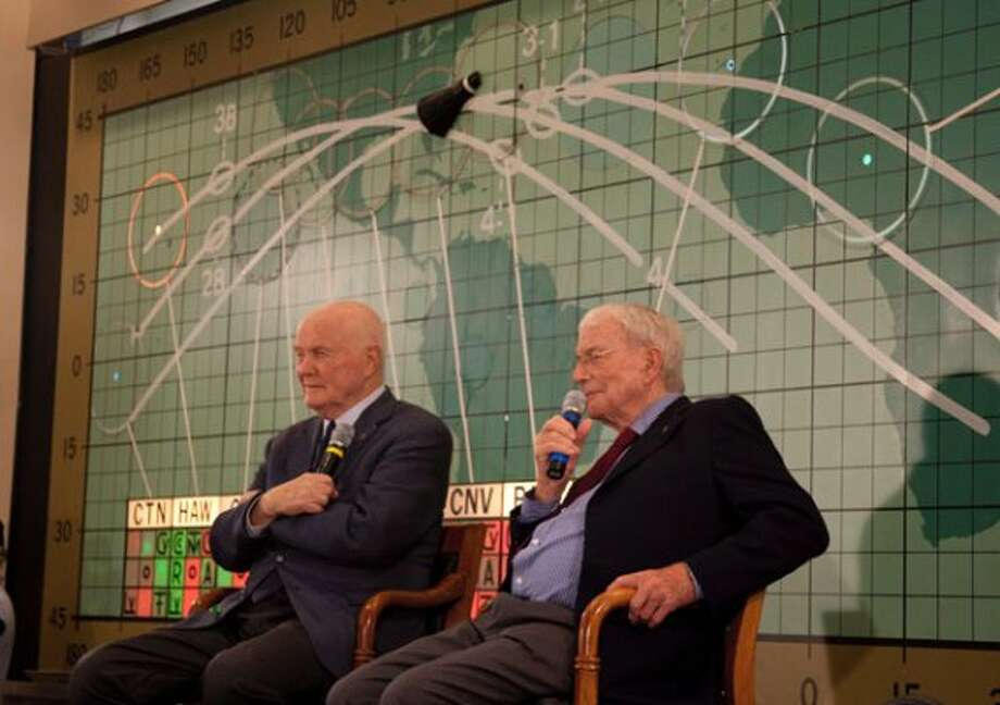 Former Sen. John Glenn, left, and Scott Carpenter, right, speak at the Kennedy Space Center, Feb. 17, 2012 in Cape Canaveral. John Glenn fever has taken hold in the U.S. once again. Three days before the 50th anniversary of his historic flight, the first American to orbit the Earth addressed employees at Kennedy Space Center. (AP Photo/Michael Brown) (Associated Press)