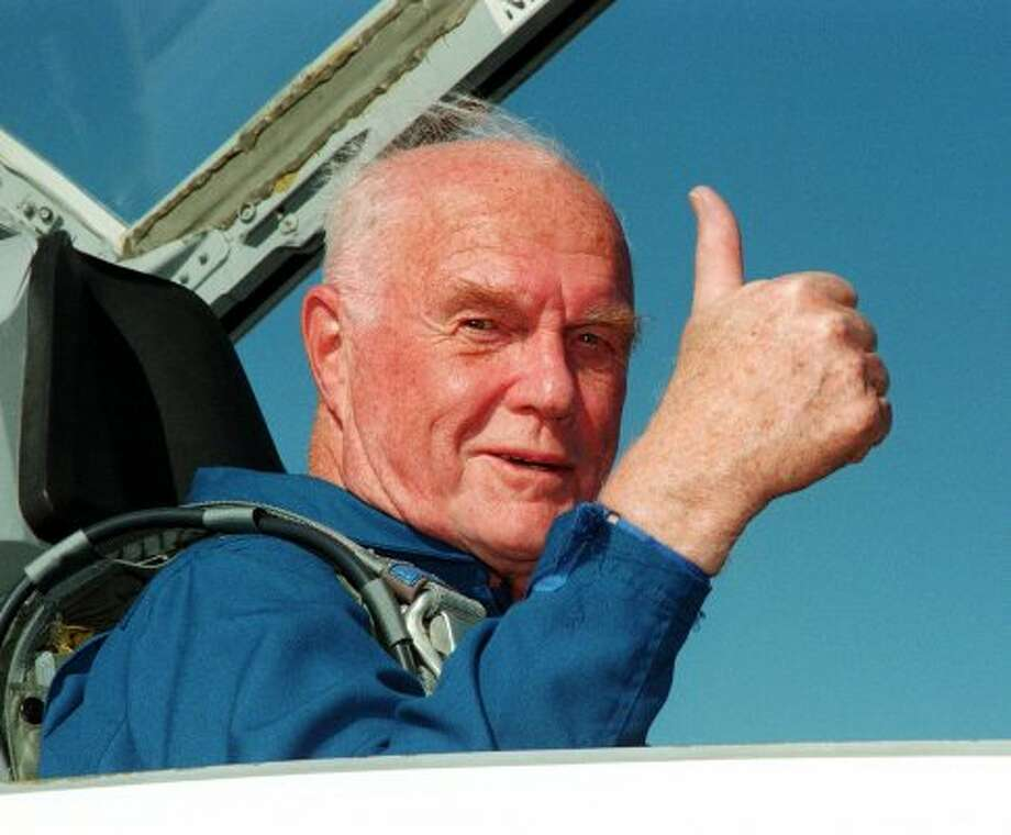Sen. John Glenn, D-Ohio, gives the thumbs up to a photographer as he sits in the back seat of a T-38 jet after arriving at Kennedy Space Center's Shuttle Landing Facility Monday afternoon, Oct. 26, 1998 in Cape Canaveral. (AP Photo/NASA, George Shelton)  (GEORGE SHELTON / AP)