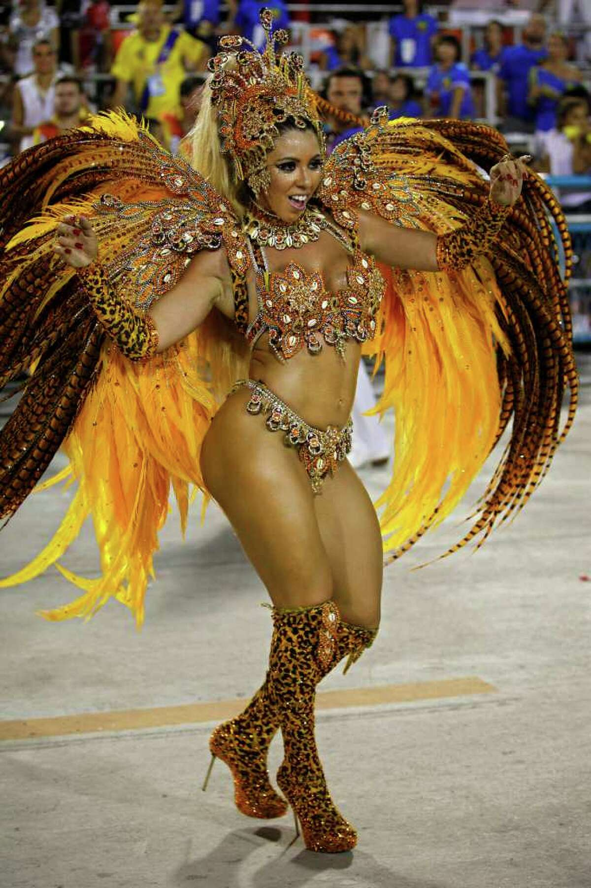 A dancer performs during Vila Isabel samba school parade at the Sambadrome during carnival celebrations in Rio de Janeiro, Brazil, Monday. Millions watched the sequin-clad samba dancers at Rio de Janeiro's iconic Carnival parade.