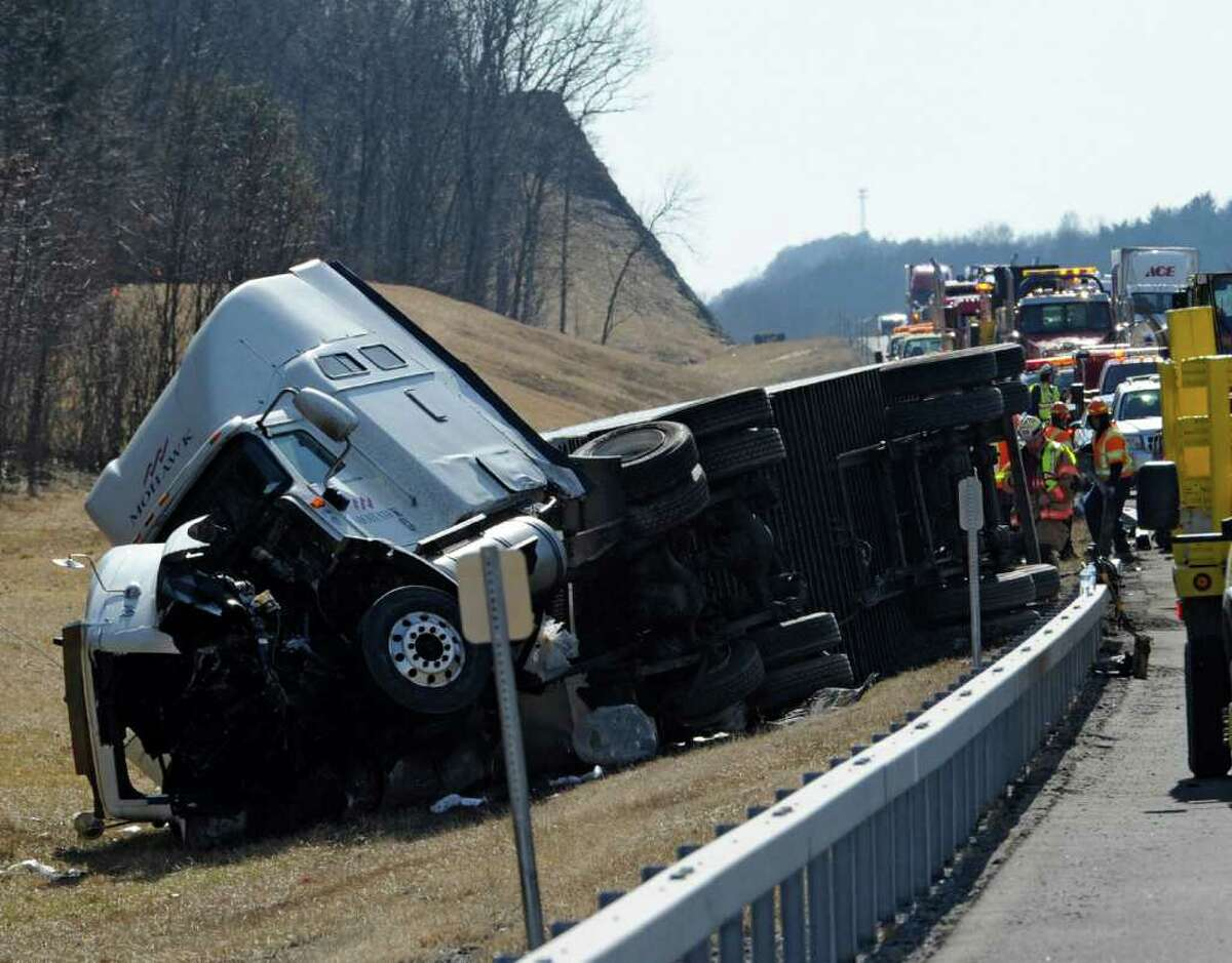 New York State Police and Thruway officials investigate the cause of a late morning roll over of a tractor trailer at mile marker 129.5 in the northbound lane of I-87 in New Baltimore, N.Y. February 20, 2012. (Skip Dickstein / Times Union)