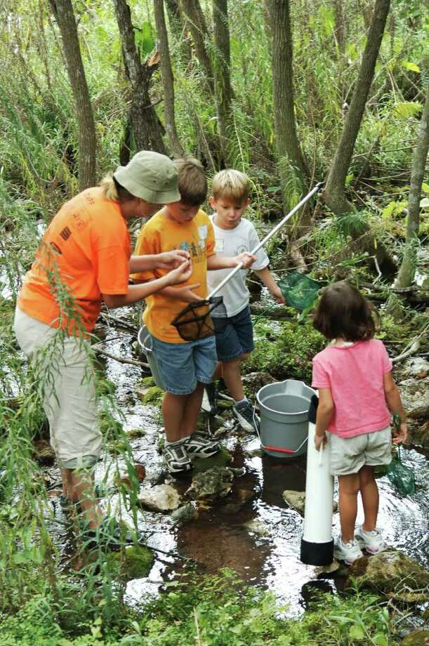 Children explore wetlands during a Texas Outdoor Family program, run by Texas Parks and Wildlife Department.