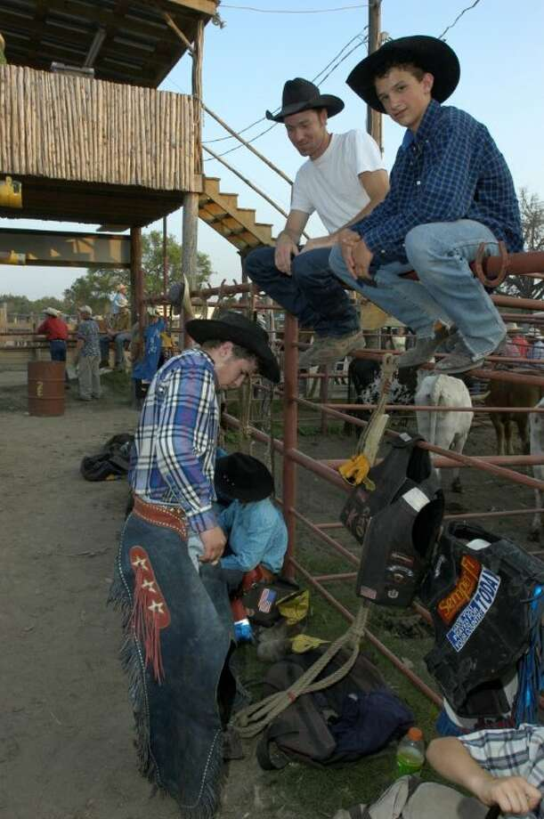 Young rodeo cowboys getting ready for their 8 second ride at the weekly Bandera rodeos. (J. Griff Smith, TXDOT) Photo: Texas Hill Country