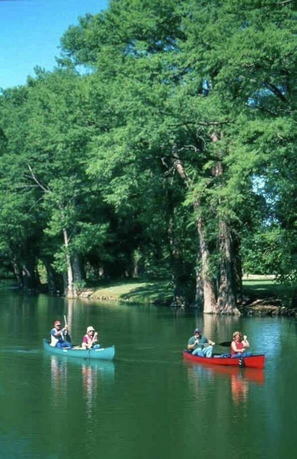 Visitors enjoy canoeing on the Guadalupe River in Kerrville. (Kerrville Convention & Visitors Bureau) Photo: Kerrville Convention & Visitors Bureau, Texas Hill Country / Kerrville Convention & Visitors Bureau