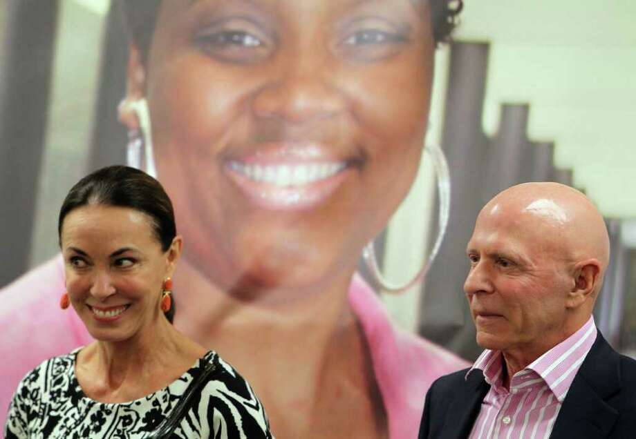 Sue Smith left, and her husband Lester Smith during press conference at Harris County Hospital District headquarters to announce largest donation ever to the district, $15 million from the Lester and Sue Smith Foundation Wednesday, April 20, 2011, in Houston. Lester Smith has battled both bladder and prostate cancer. ( James Nielsen / Houston Chronicle ) Photo: James Nielsen / Houston Chronicle