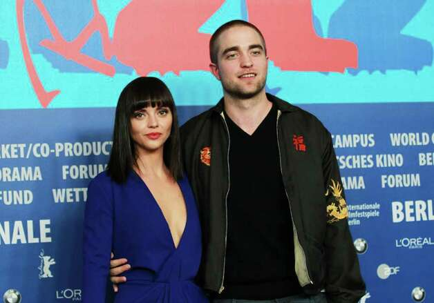Actress Christina Ricci poses with Pattinson and a new haircut at the Berlin International Film Festival in 2012. New haircut, same youthful look. You're not fooling anyone, Robert.  Or should we say ... Mr. Vampire. (Getty Images) Photo: Sean Gallup, Getty Images / 2012 Getty Images