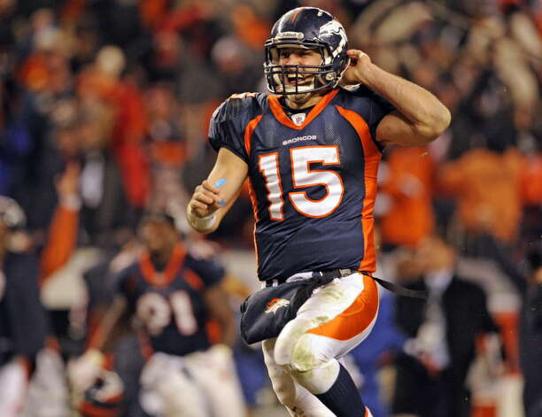 Denver Broncos quarterback Tim Tebow celebrates his 80-yard touchdown pass in overtime, giving the Broncos a 29-23 win over the Pittsburgh Steelers in an NFL football wild card playoff game Sunday, Jan. 8, 2012, in Denver. (AP Photo/The Denver Post, AAron Ontiveroz)