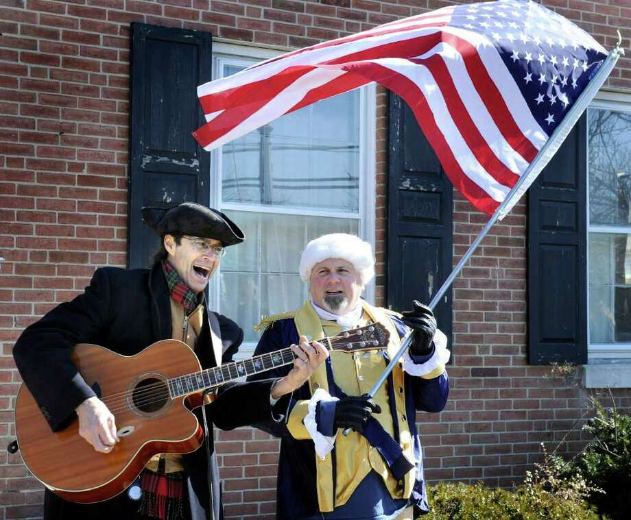 Billy Michael, left, stands with John Opinski as George Washington in front of the old Bethel Town Hall Monday afternoon. Michael, who is with the Bethel Action Committee, staged a BAC Presidents Day Rally to show opposition to the town's plan to tear down the town hall building for a parking lot. Photo taken Monday, Feb. 20, 2012. Photo: Carol Kaliff / The News-Times