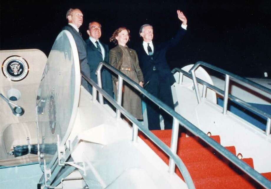 Former Presidents Gerald Ford, Richard Nixon and Jimmy Carter stand on the steps in front of the Boeing VC-137C SAM 26000.  President Nixon flew aboard SAM 26000 on his historic first visit by an American President to China, in February 1972, and on his visit to the Soviet Union in May 1972. It also served Nixon National Security Advisor Henry Kissinger on 13 trips to Paris for secret meetings with the North Vietnamese. Although it became the backup to SAM 27000 in December 1972, SAM 26000 went on to carry Presidents Ford, Carter, Ronald Reagan, George H.W. Bush and Bill Clinton. Photo: U.S. Air Force