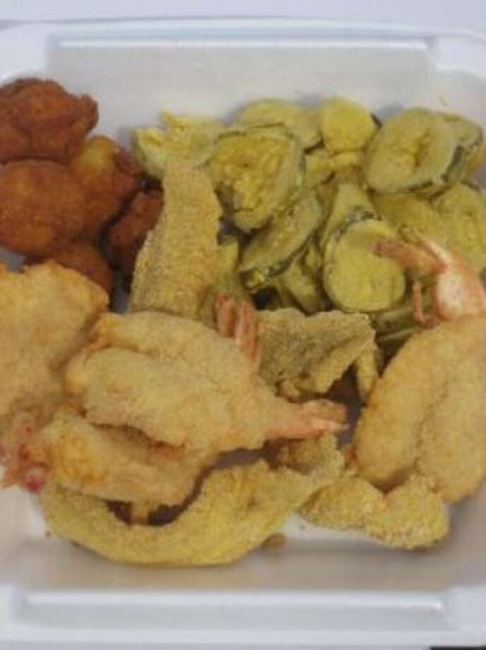 Fried shrimp, hush puppies, and deep fried pickles.