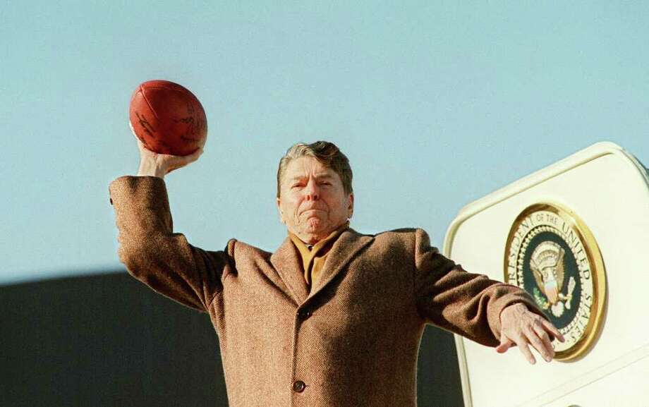 President Ronald Reagan ordered the two 747-200s that now serve as the primary presidential aircraft, but they entered service after he left office. Here, Reagan throws a football toward the press on January 11, 1988 as he boards an unidentified Air Force One, probably SAM 27000, to return to Washington. SAM 27000 replaced SAM 26000 as the primary presidential jet in 1972. Photo: JEROME DELAY, AFP/Getty Images / AFP